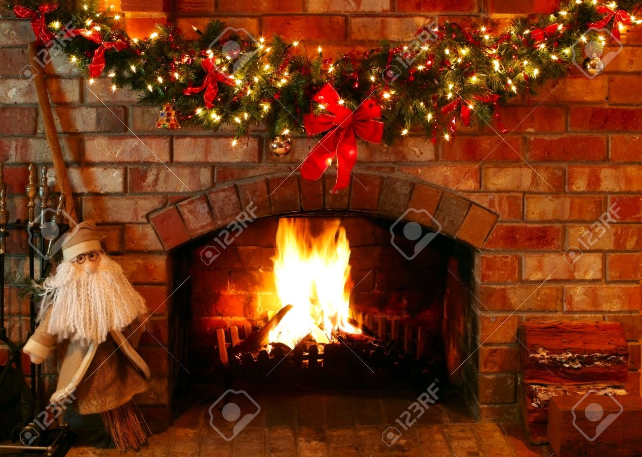 christmas garland and lights over a log fire with santa as a