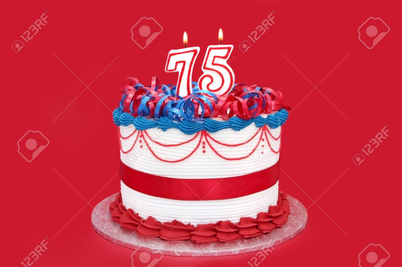 75th Cake With Numeral Candles On Vibrant Red Background Stock Photo