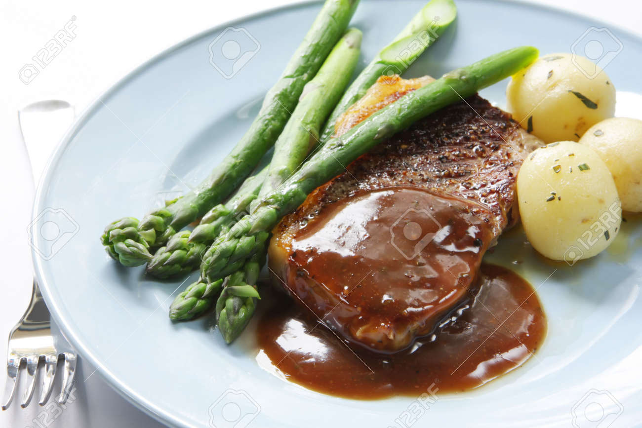 Beef Steak With Peppercorn Sauce Potatoes And Asparagus Stock Photo 2030037