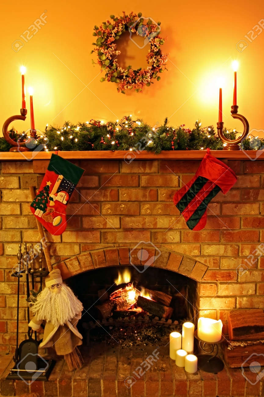 open log fire with christmas candles garland broomstick santa
