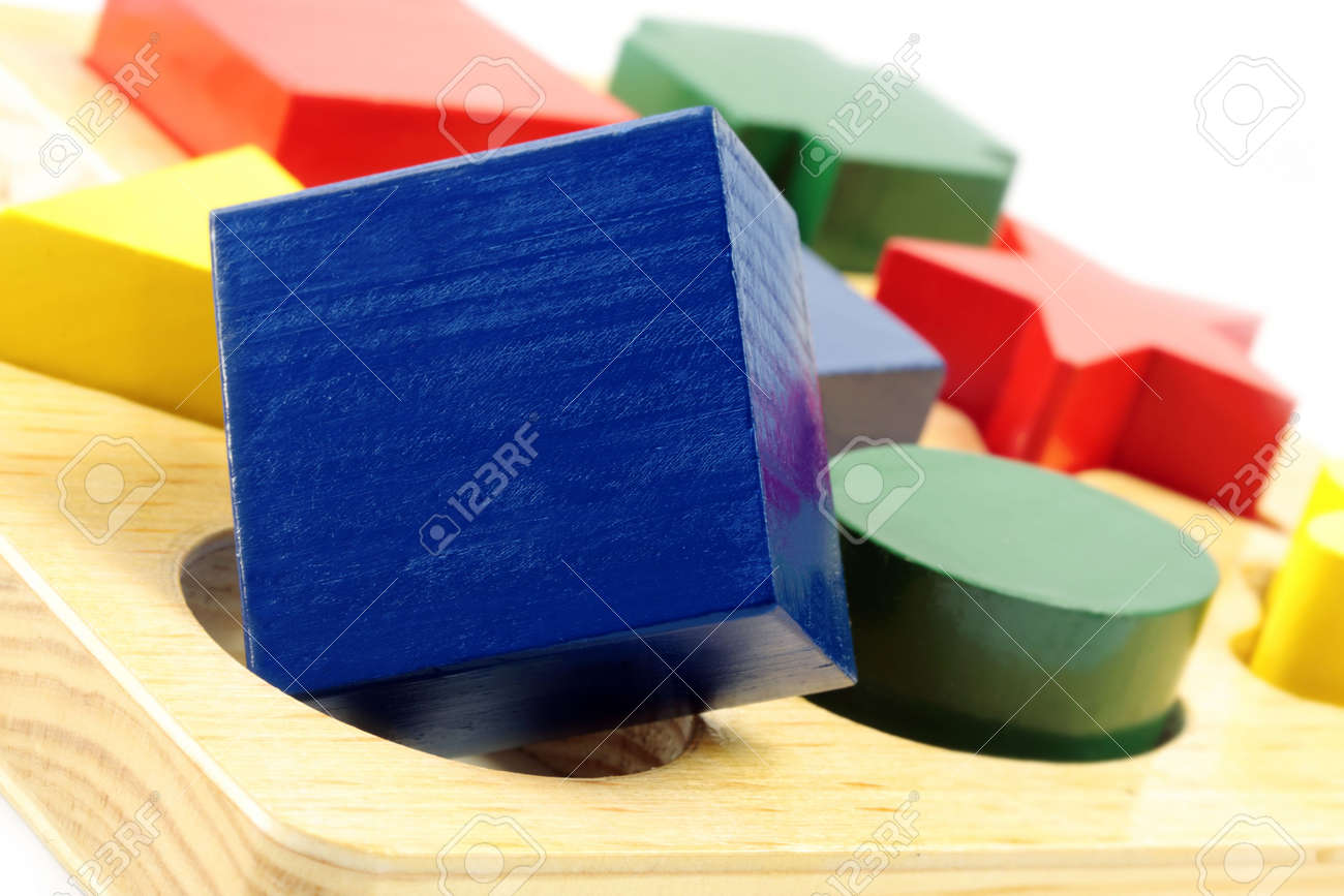 Square peg in a round hole.  Wooden block shapes, with square block over round hole. Stock Photo - 3587460
