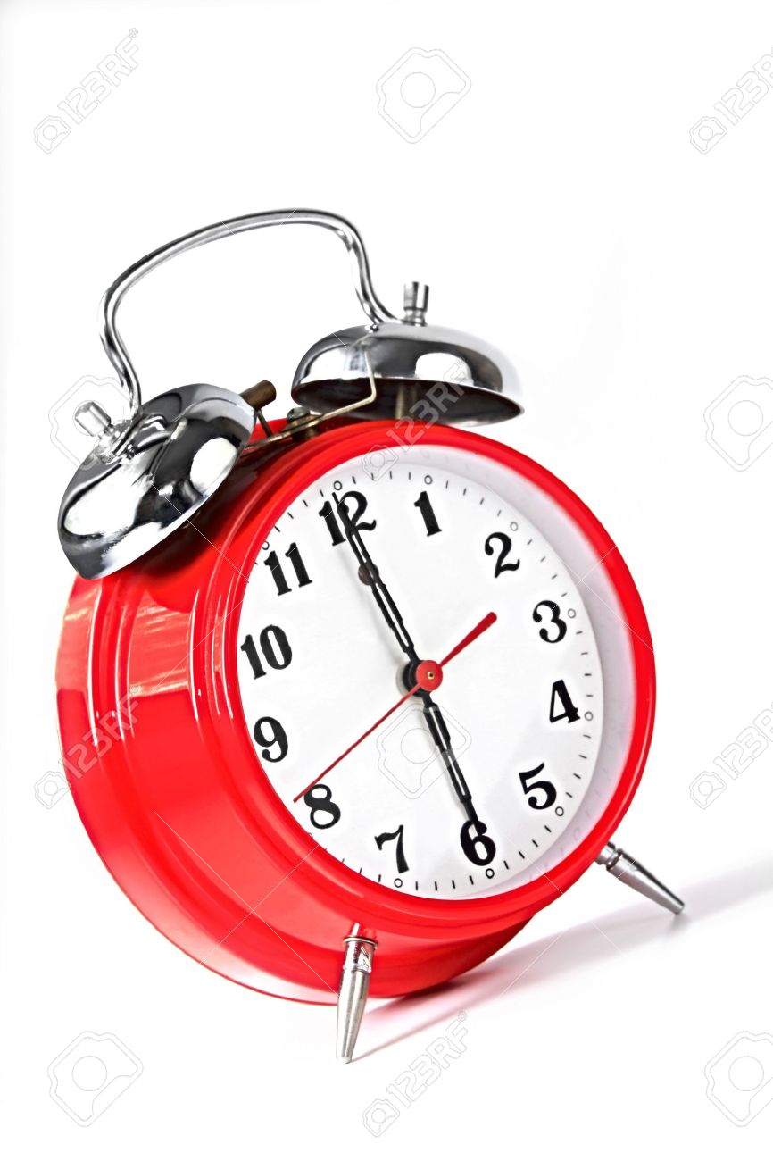 Red alarm clock set to 6 00am  Natural early morning light