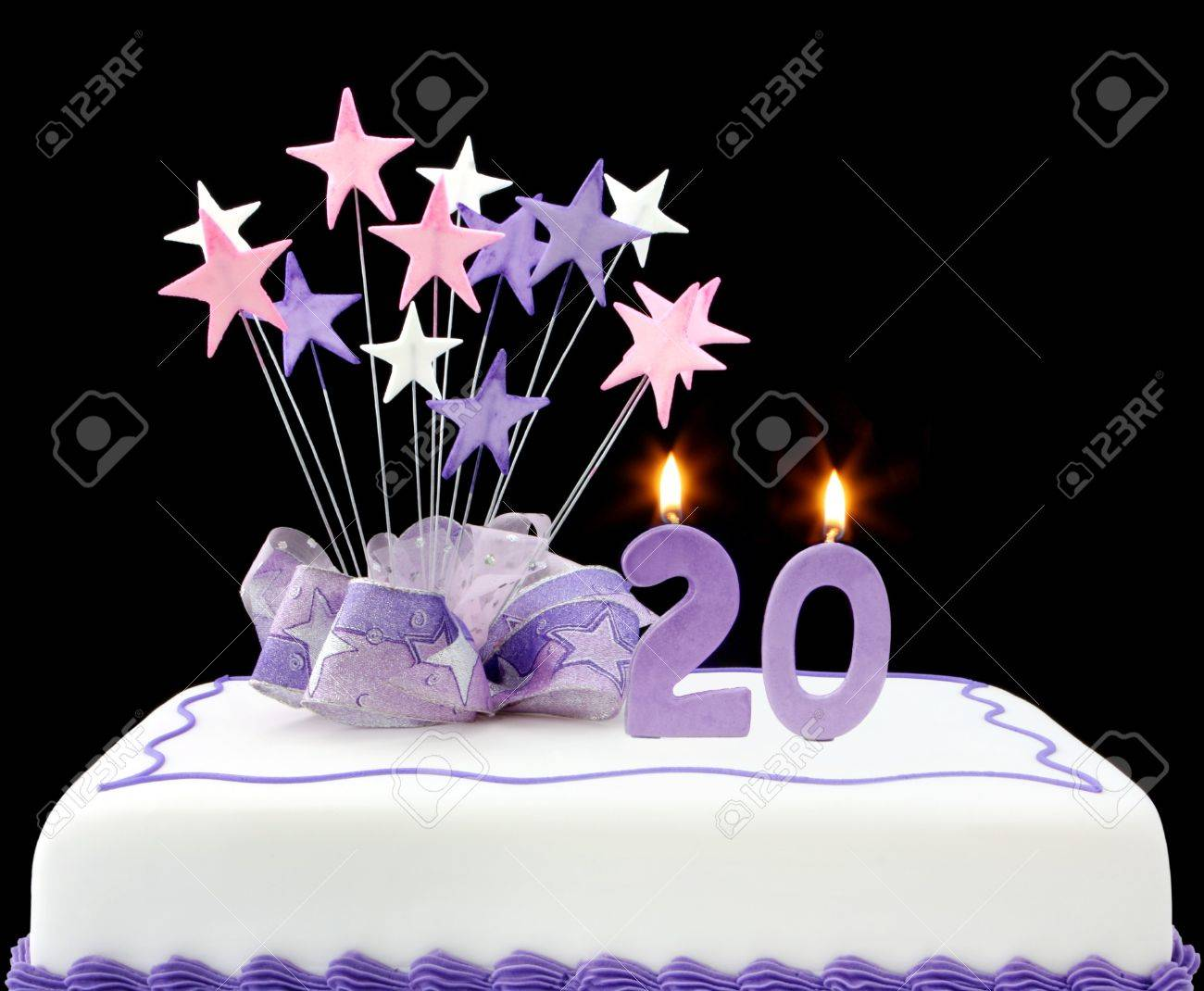Fancy Cake With Number 20 Candles Decorated With Ribbons And