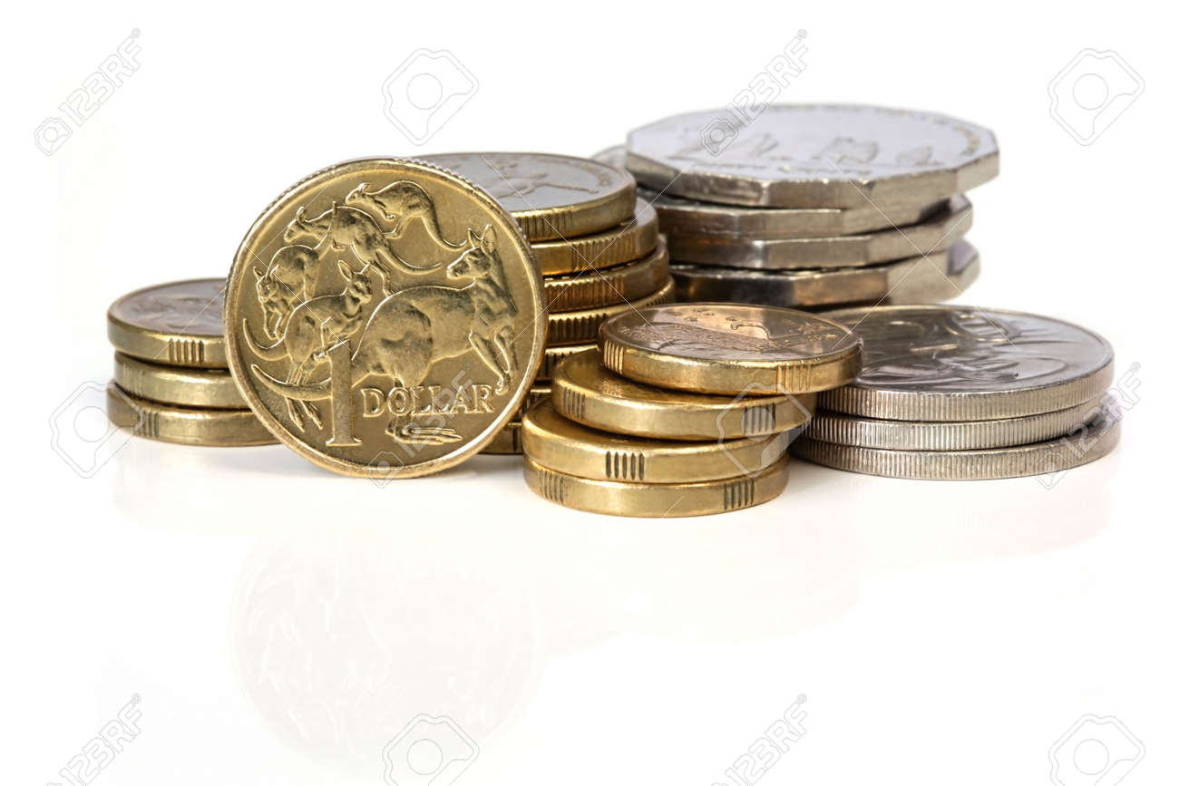 Stacks of Australian coins, reflected on white surface. Stock Photo - 4731250