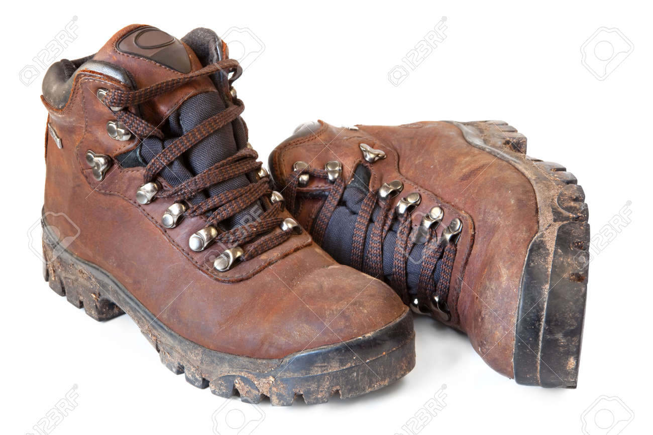 Hiking boots, well worn and muddy, isolated on white. Stock Photo - 5680209