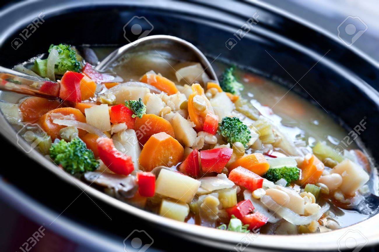 Vegetable soup, slow-cooked in a crock pot, ready to serve. - 5747074