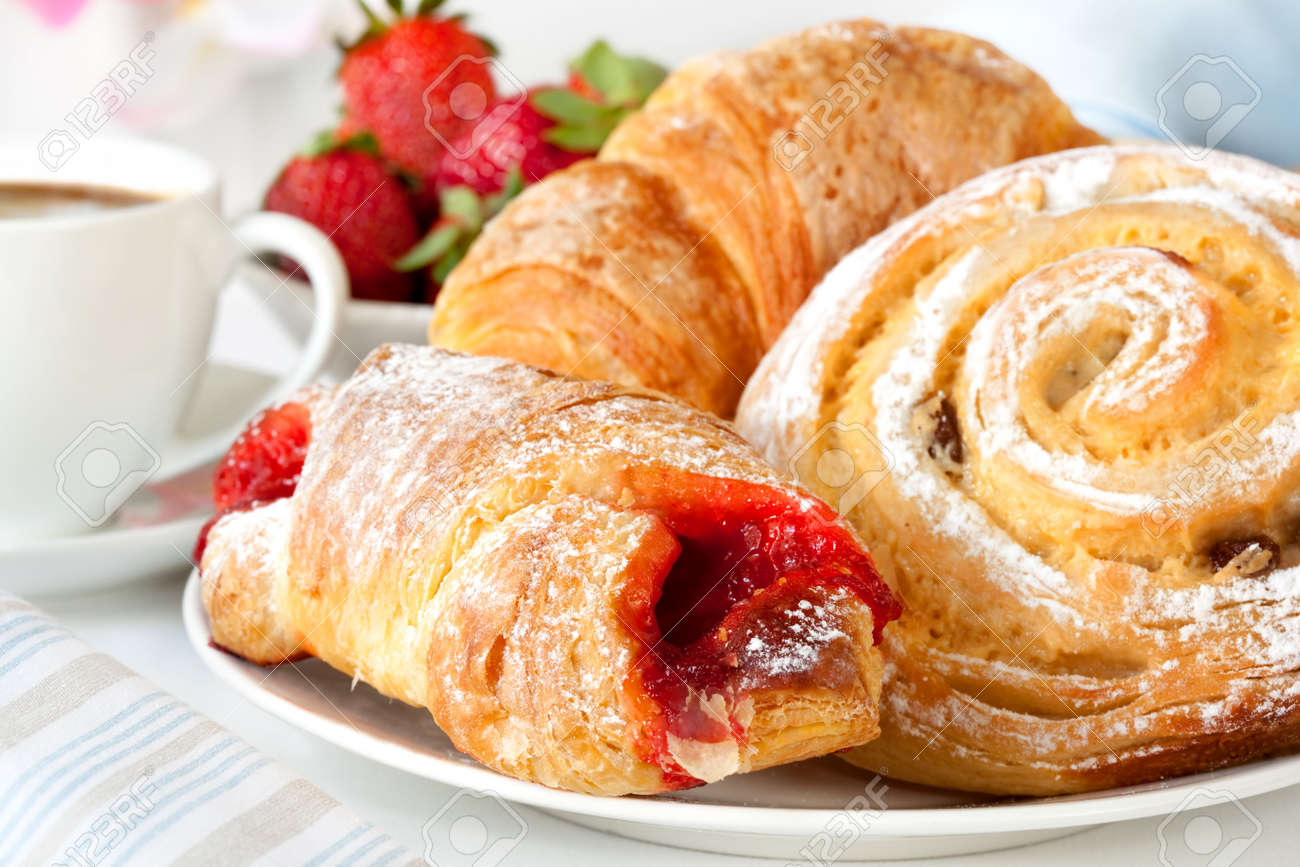 Continental breakfast with assortment of pastries, coffees and fresh strawberries. Stock Photo - 5747071