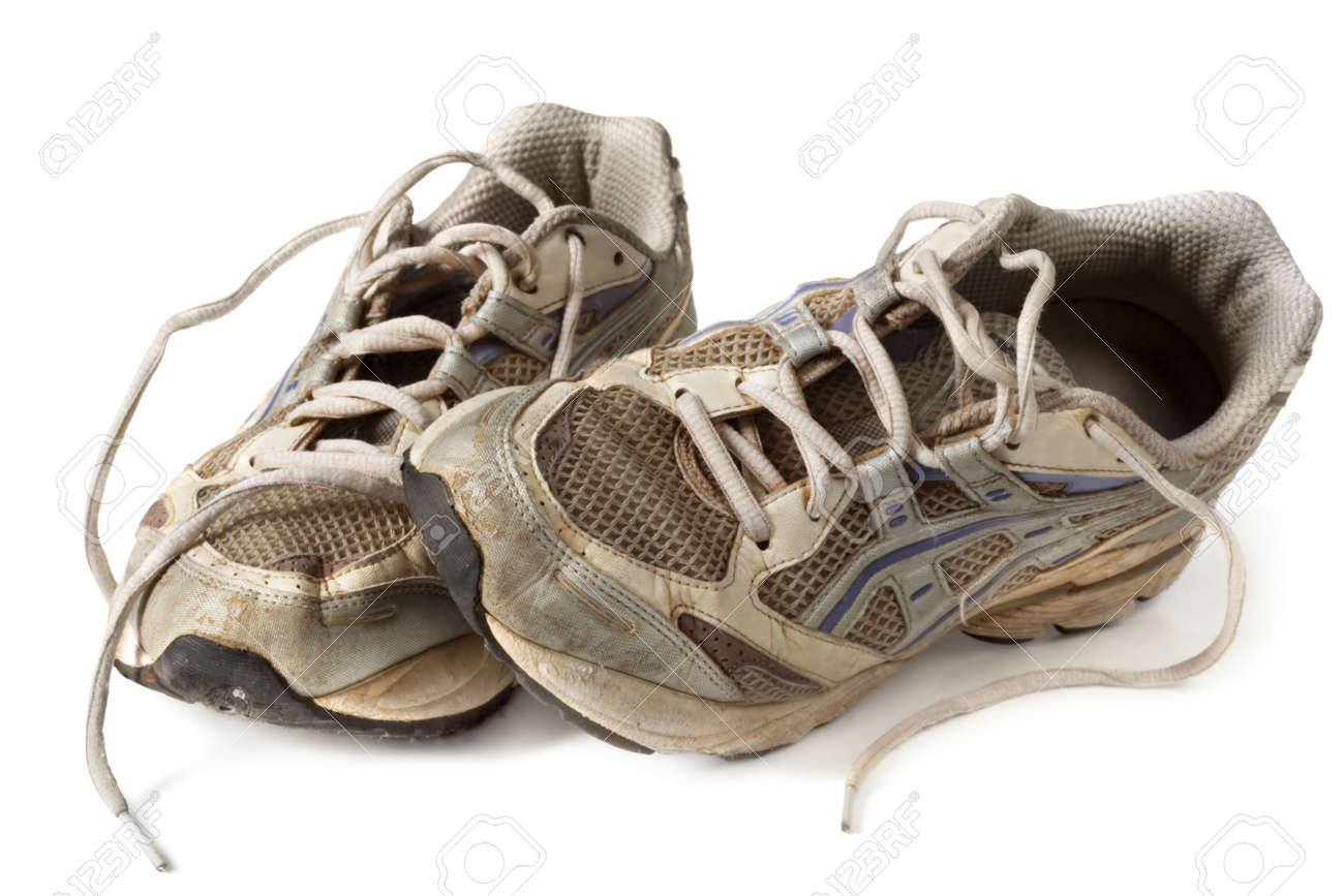 Battered old sneakers, isolated on white.  These have definitely seen better days! Stock Photo - 6054551