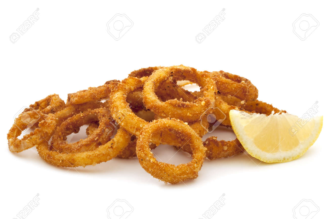 Pile of fried onion rings with a lemon wedge, over white background. Stock Photo - 9272998