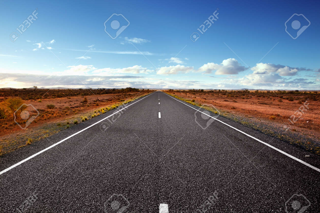 Highway in the Australian Outback.  Western New South Wales. Stock Photo - 9412726