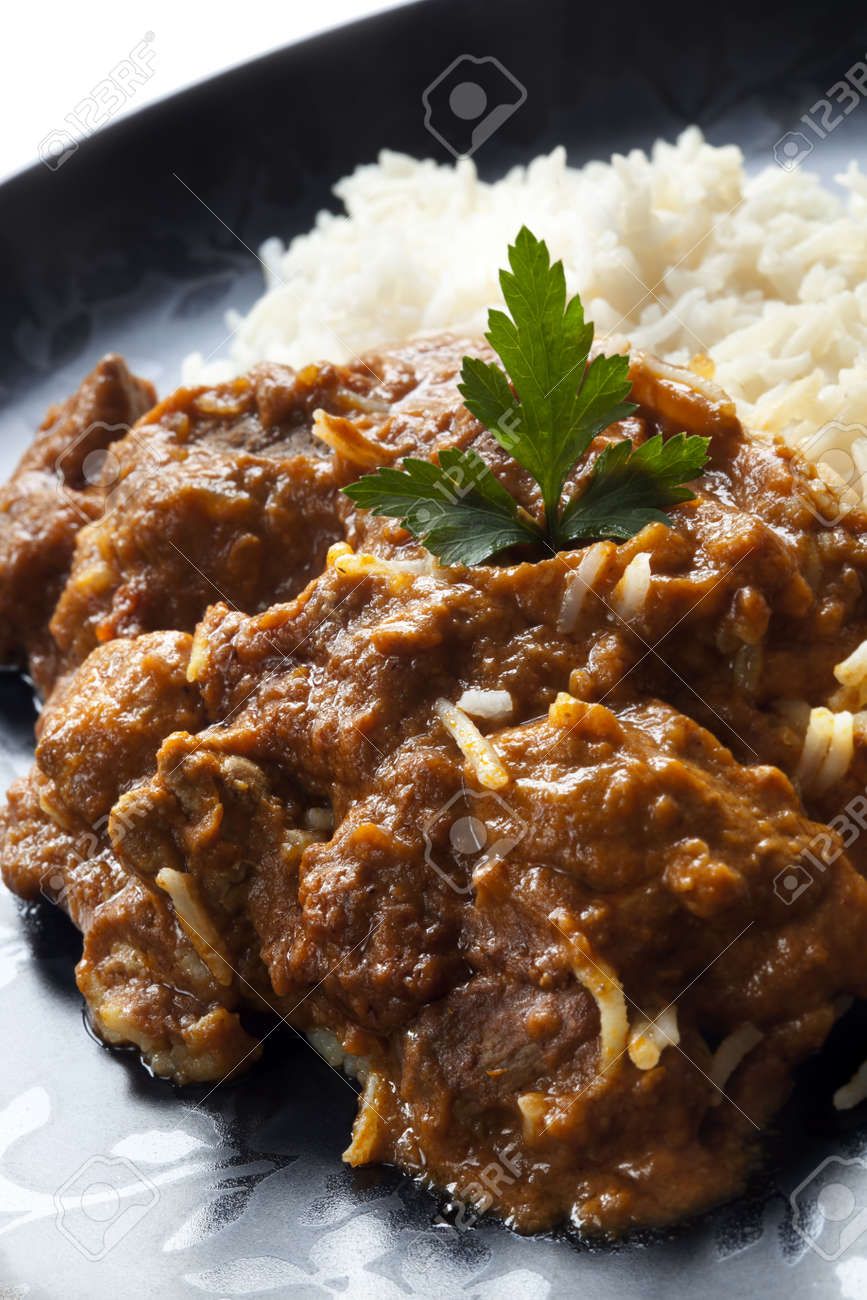Rogan josh with rice.  Delicious Indian curry. Stock Photo - 9887640
