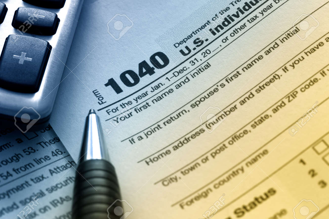 Us tax form 1040 with pen and calculator stock photo picture and us tax form 1040 with pen and calculator stock photo 17842634 falaconquin