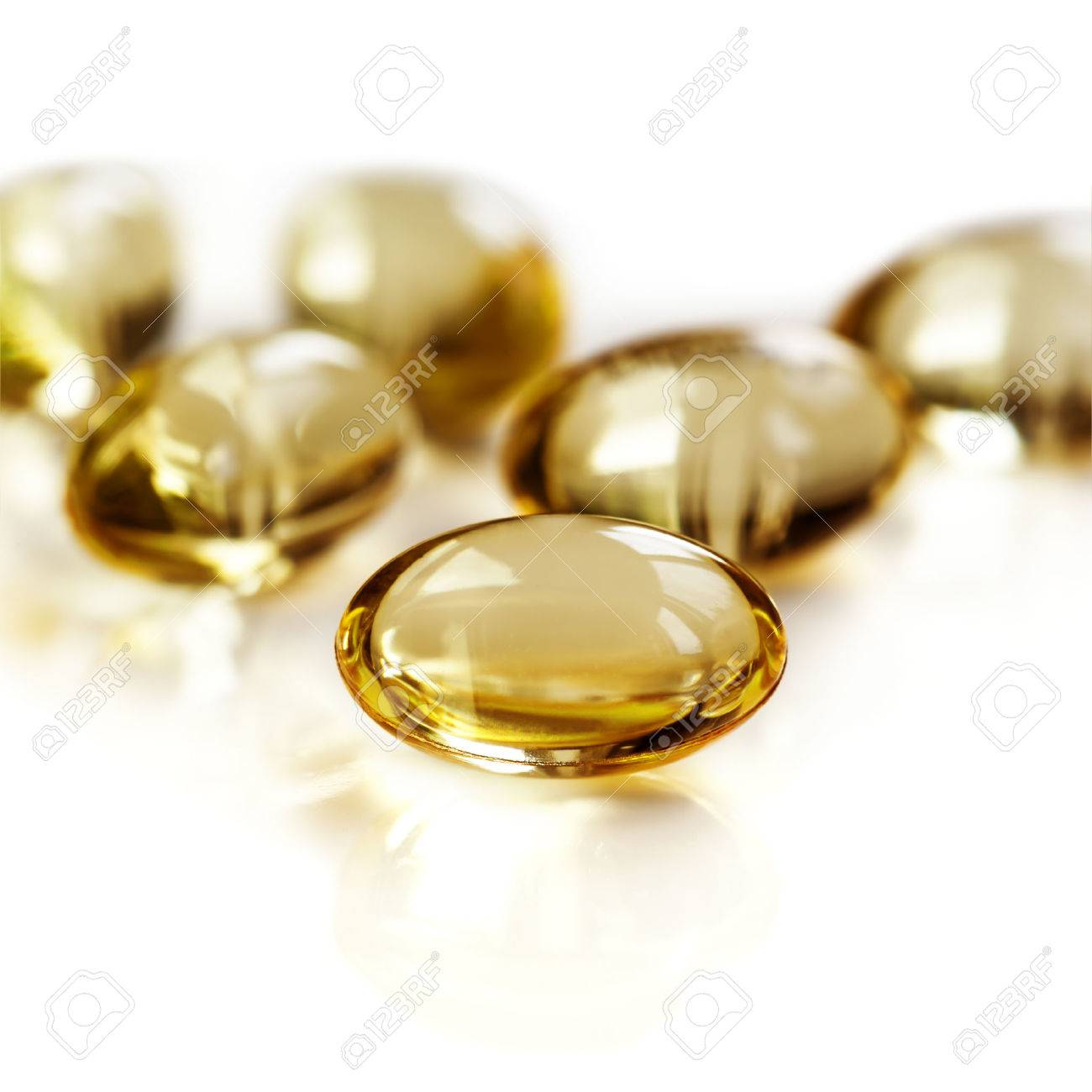 Gel capsules isolated on white. Vitamin D. - 30204098