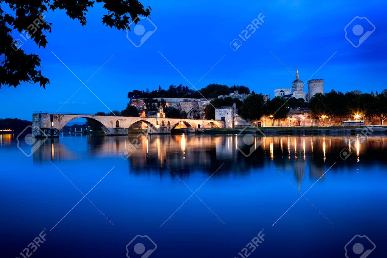 Avignon Bridge, France, viewed at night. With the Papal Palace. - 30537612