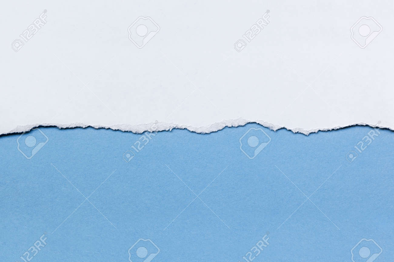 Torn white paper over blue background. - 31452479