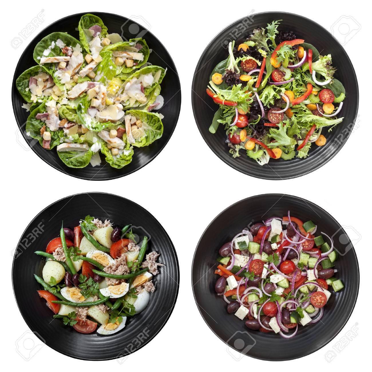 Set of different salads on white background. Includes chicken caesar, garden, nicoise, and Greek. - 32575777