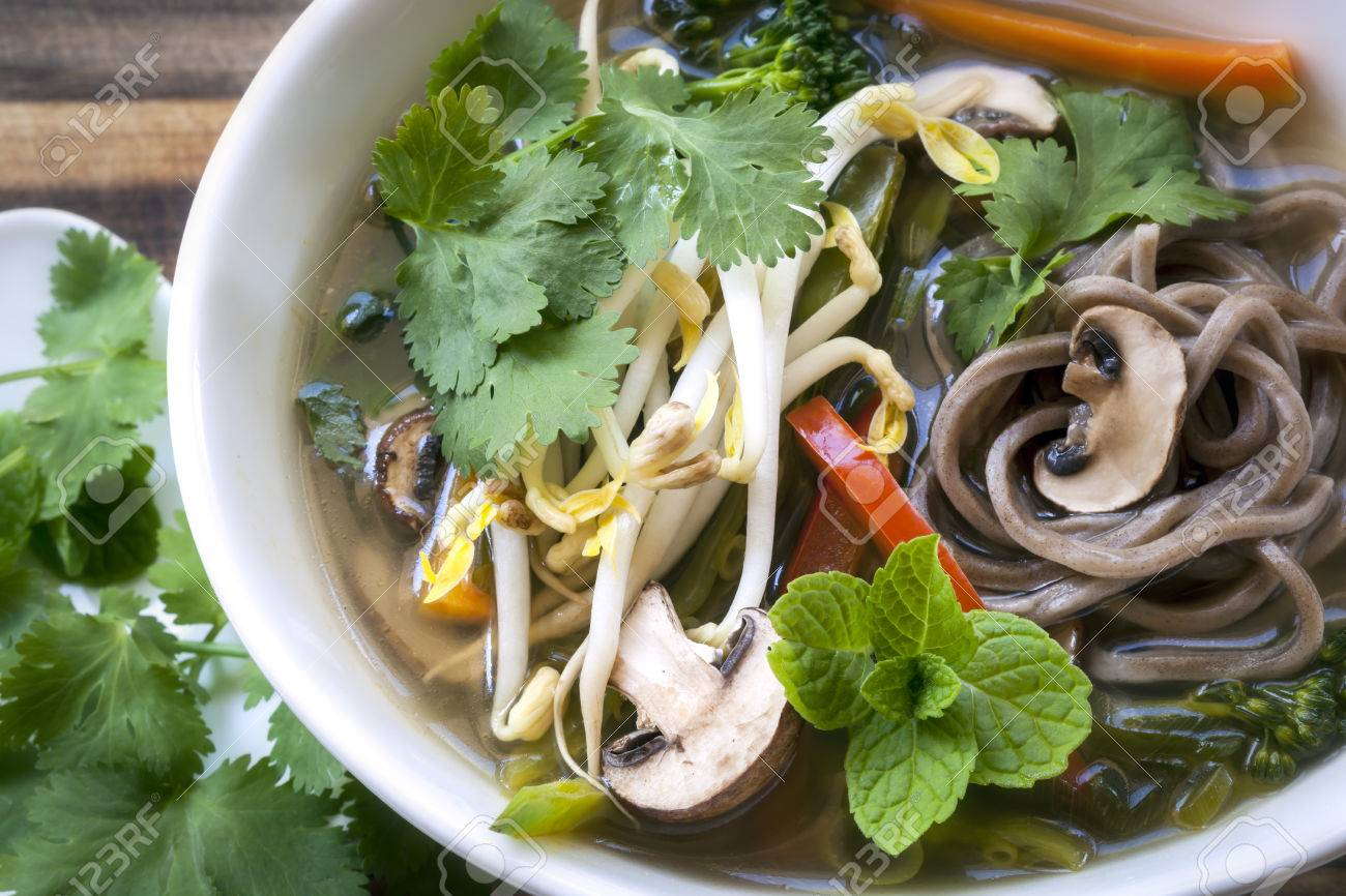 Hot And Sour Vegetable Soup With Soba Noodles And Bean Sprouts Garnished With Mint And