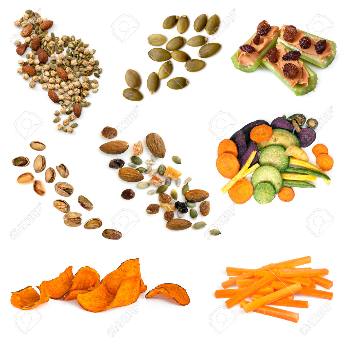 Healthy snacking collection isolated on white. Includes seeds, nuts, trail mix, sweet potato fries, vegetable crisps and carrot sticks. - 50492356