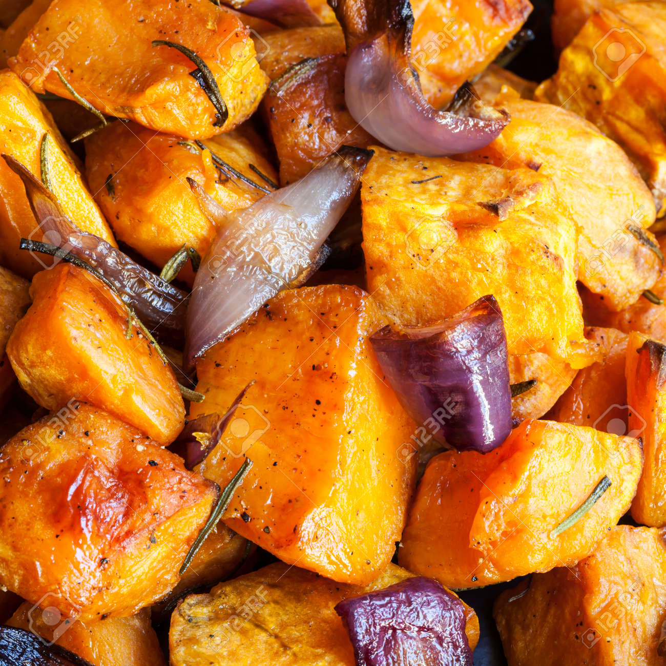 Roasted sweet potatoes with red onions and rosemary. - 50838754