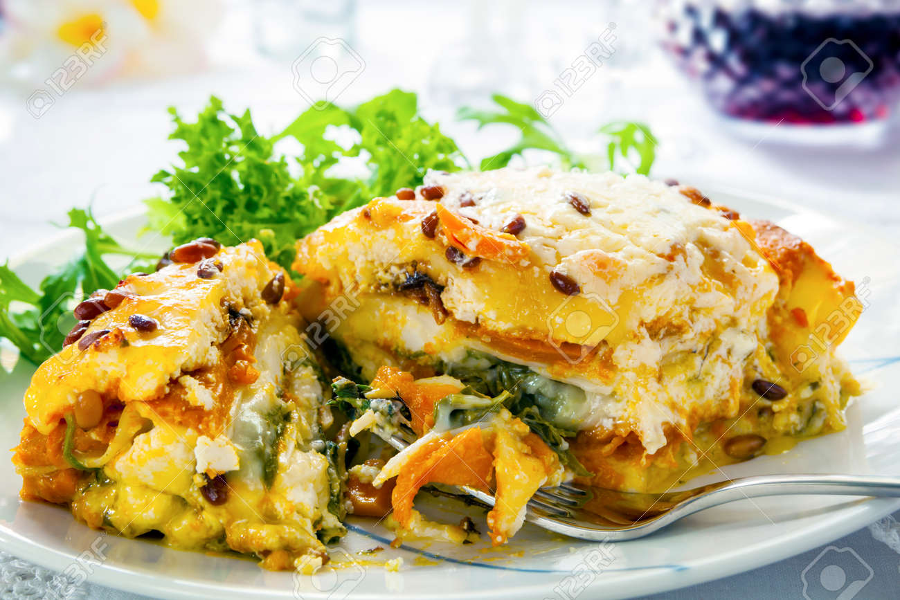 Vegetarian lasagna or lasagne. Made with sweet potato, pumpkin, spinach and pine nuts. - 50838954