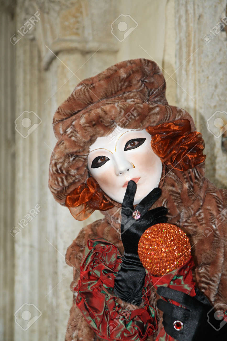 VENICE, ITALY - MARCH 3 2011: Detail of unidentified masked person standing in front of Palazzo Ducale in Venice, Italy, on 3 March during popular Venice carnival (held on 26 February - 8 March 2011). Stock Photo - 10911873