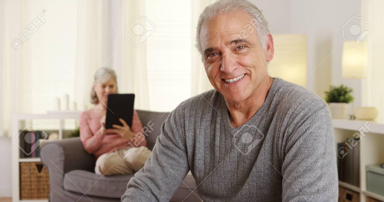 Handsome senior man smiling at camera - 110931446