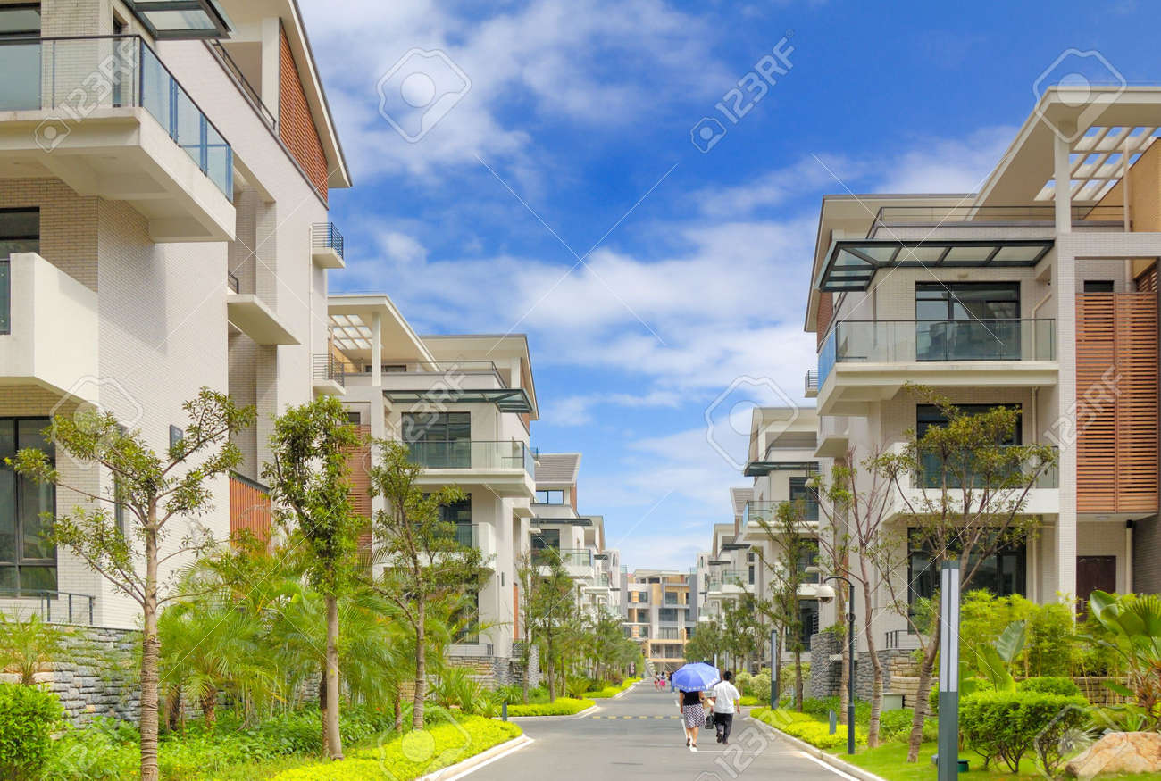 A road and two rows of new terrace houses beside it in the southeast of China,these homes are aimed at the rich buyer and buy to live in Stock Photo - 2847013
