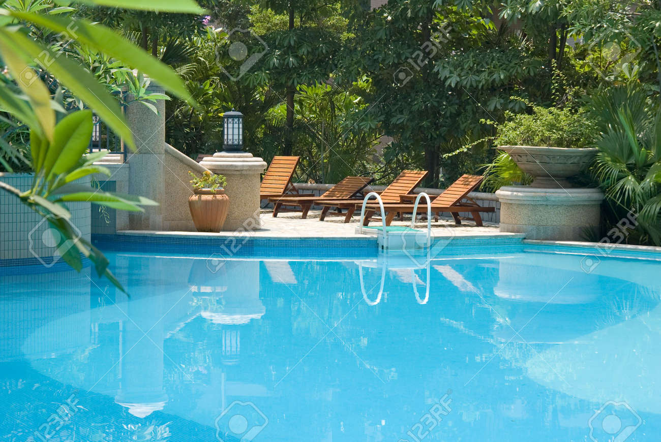 Chaise longue and swimming-pool Stock Photo - 3553742