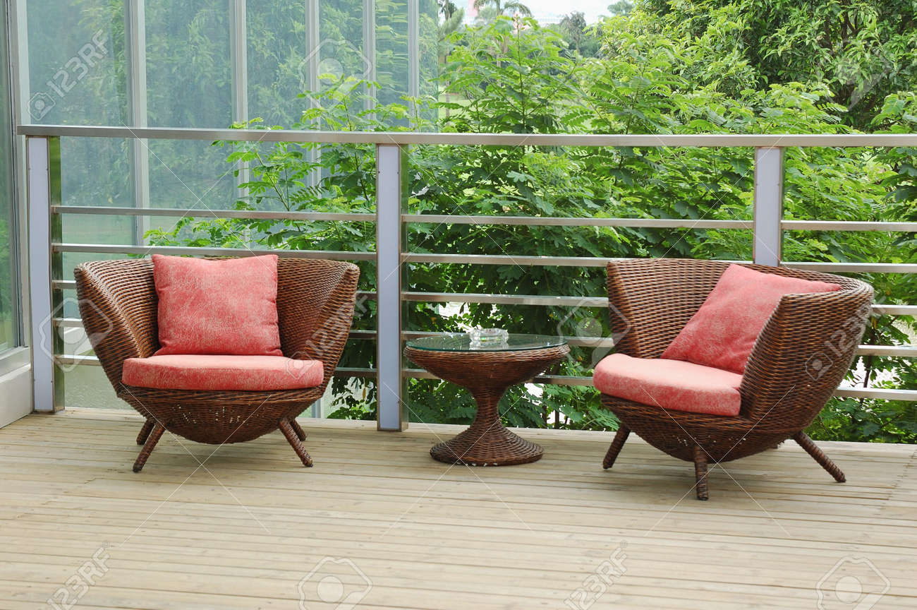 Wicker chairs on the patio in a beautiful garden. Stock Photo - 3698127