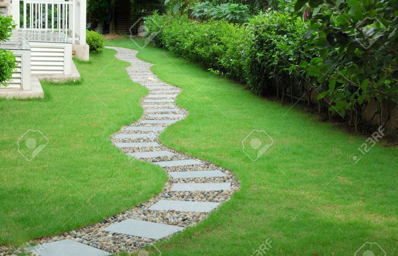 Superb Garden Stone Path With Grass Growing Up Between The Stones Stock Photo    3841578