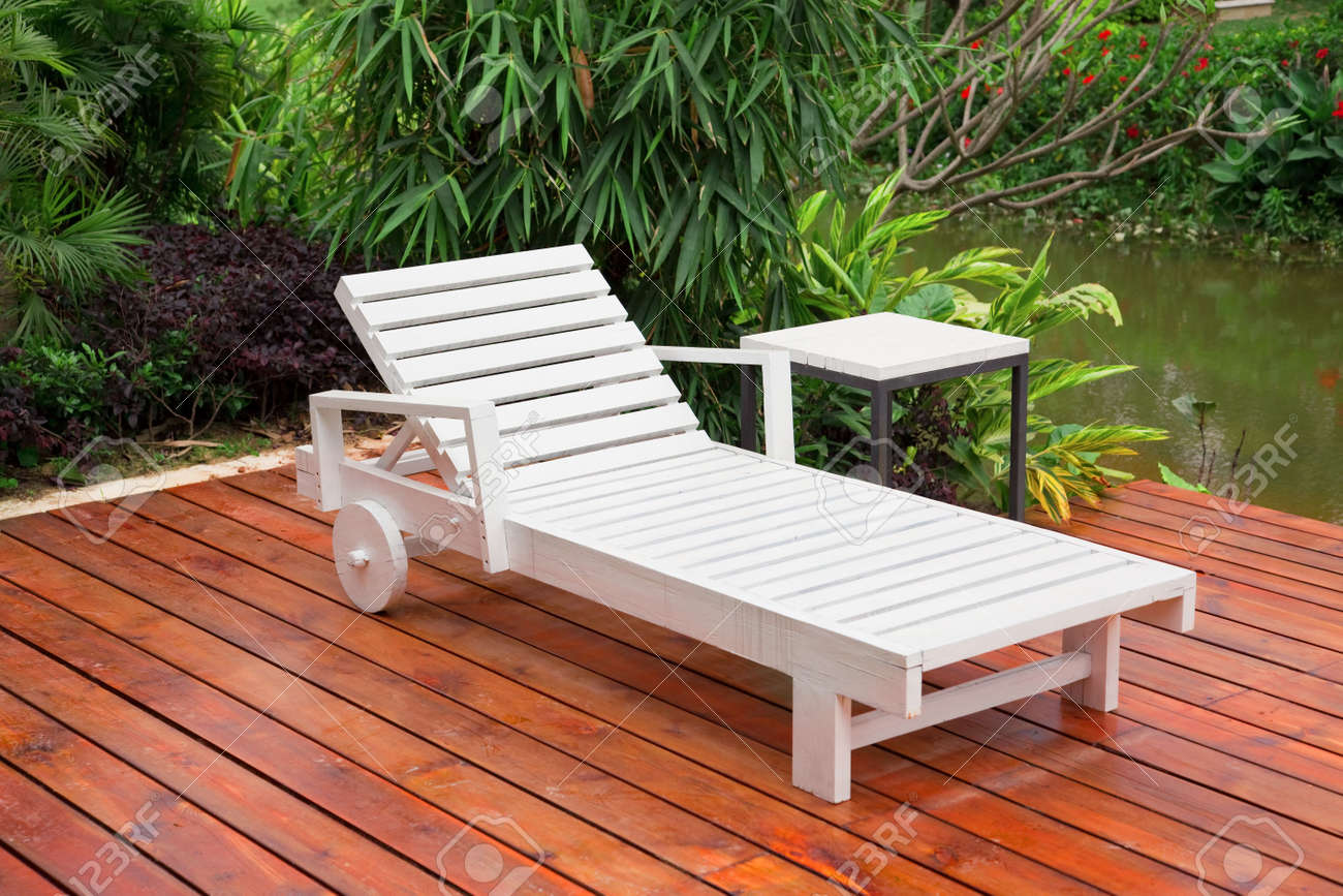 Wooden reclining chair in a garden Stock Photo - 5048094 : wooden reclining garden chairs - islam-shia.org