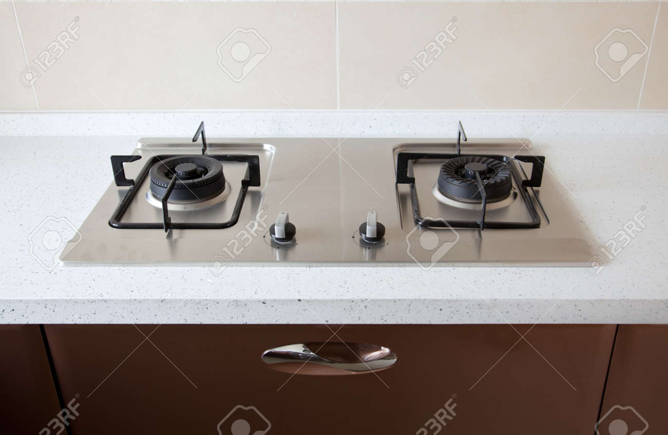 Modern Kitchen Stove new stove on mable plate in a modern kitchen stock photo, picture