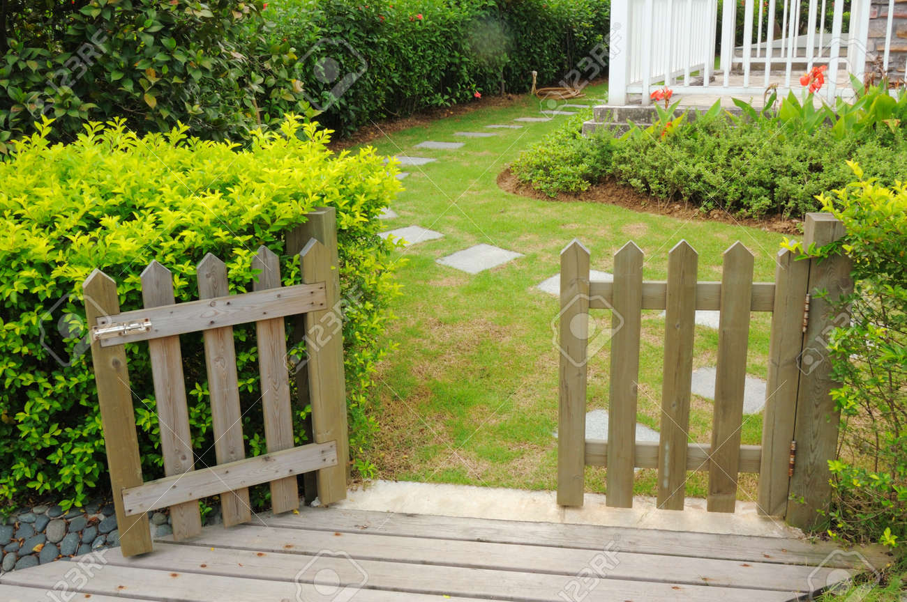 Open wooden gate and fence in yard stock photo picture and open wooden gate and fence in yard stock photo 7223549 baanklon Choice Image