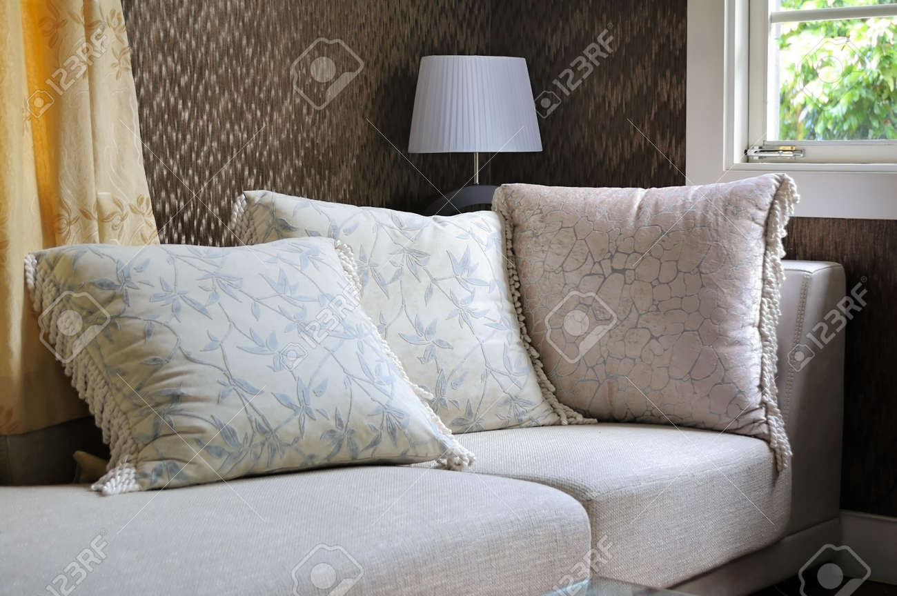 Detail of modern living room with table lamp and pillow cushions on sofa Stock Photo - 7938738