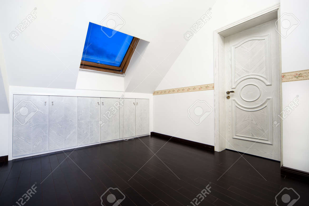 New modern attic room with a roof skylight window and wall cabinet Stock Photo - 7938767