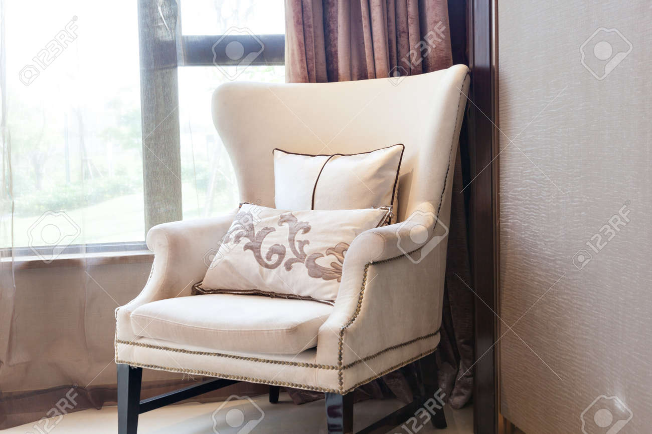 Armchair close to  the window at  a new interiors Stock Photo - 13195483