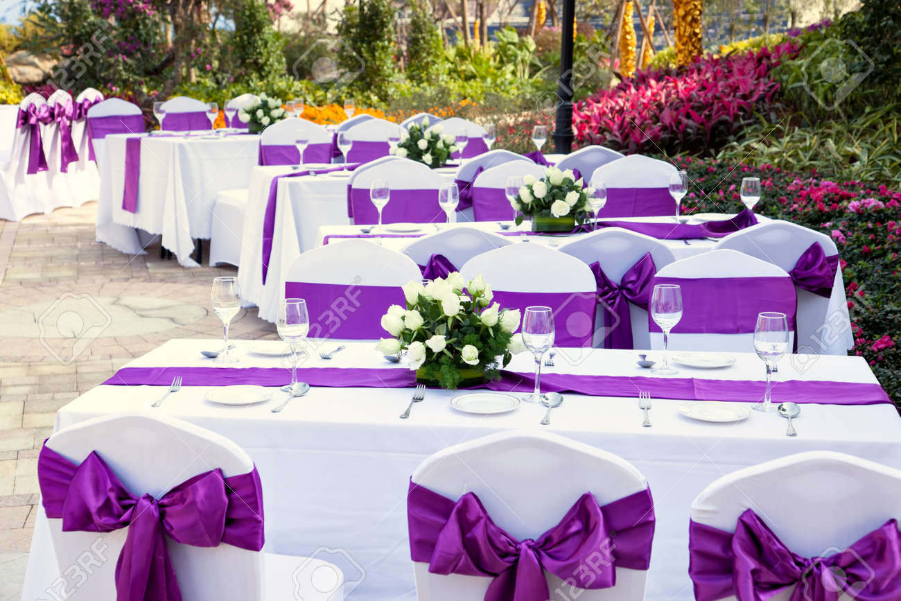 outdoor tables with served plates and wine glasses in the garden Stock Photo - 15119099