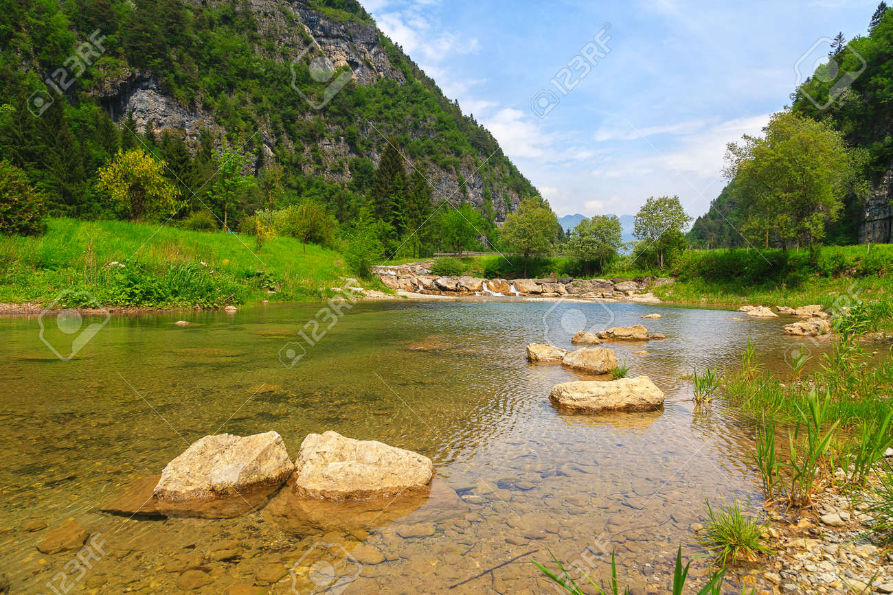 Stream with its refreshing water between the mountain peaks - 166782530