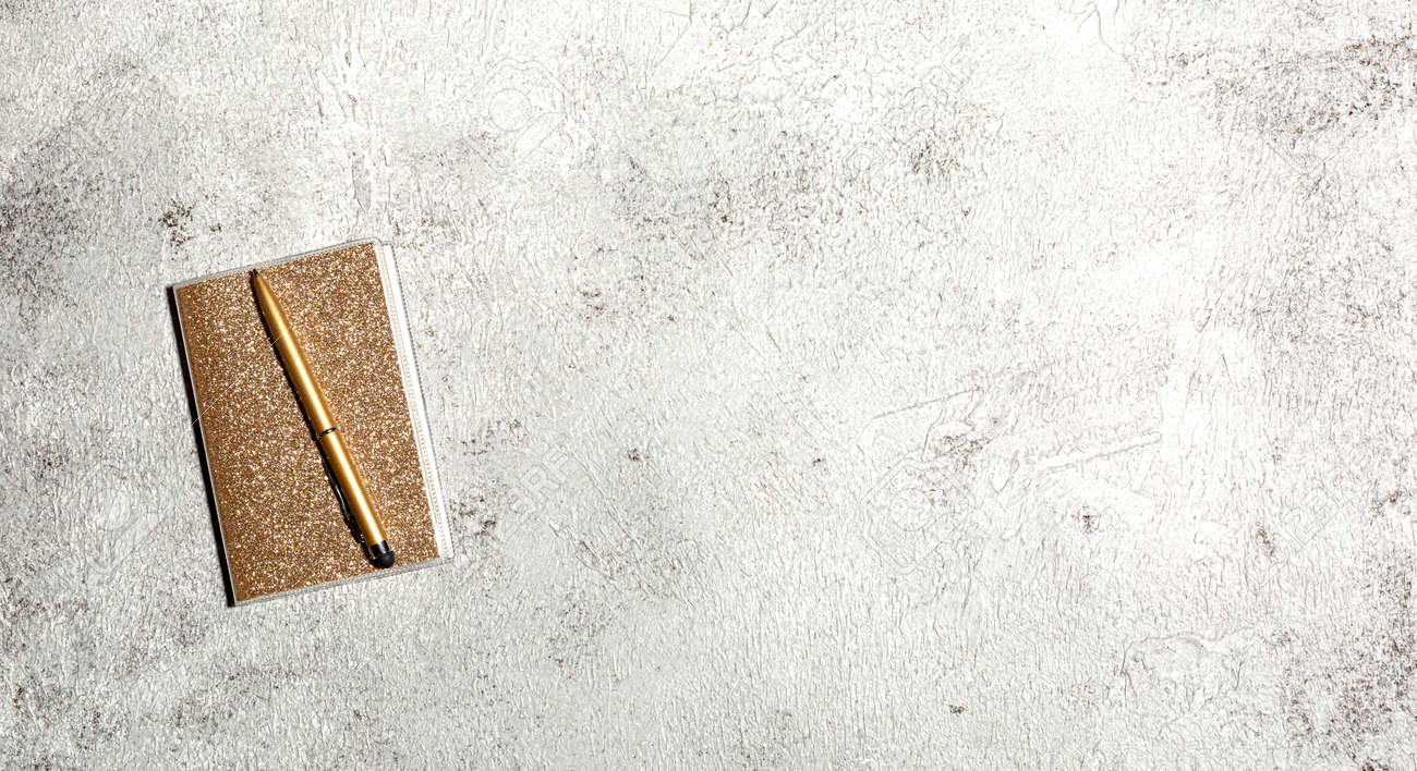 Notebook and pen on a gray concrete background. Female workspace. Top view, flat lay, copy space - 166783129