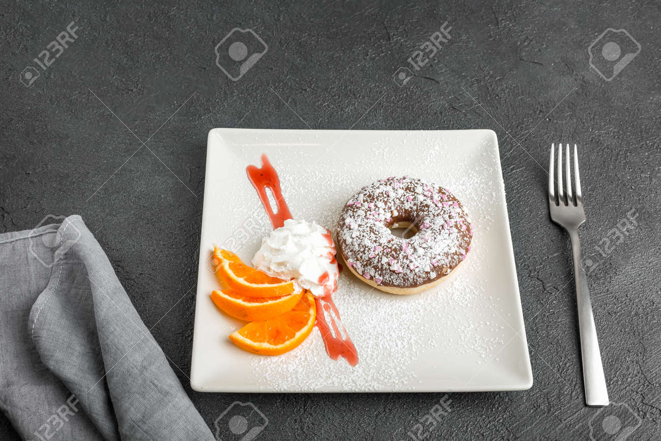 doughnut on plate isolated on black background - 167193529