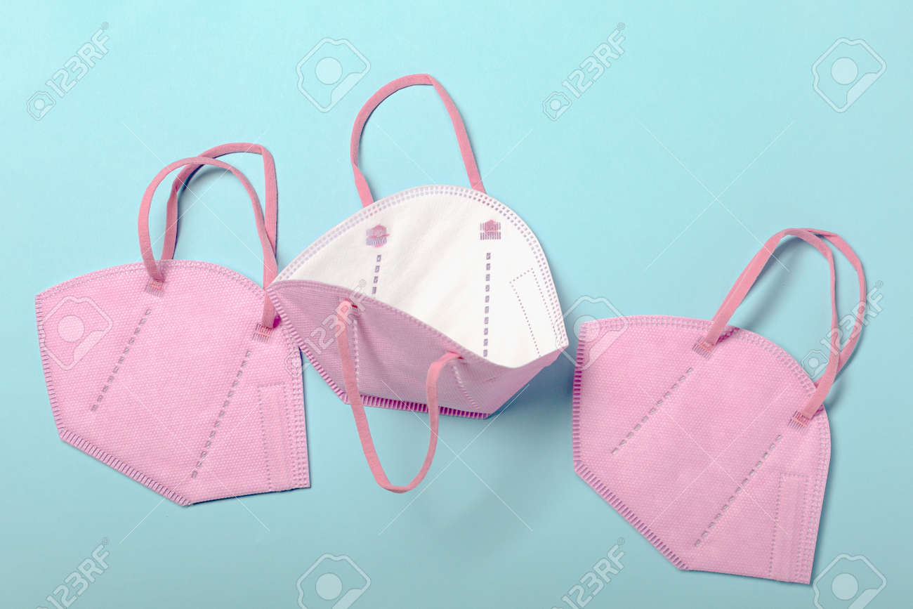Creative minimal flat lay layer with KN95 or N95 FFP2 mask for protection pm 2.5 - 167779878
