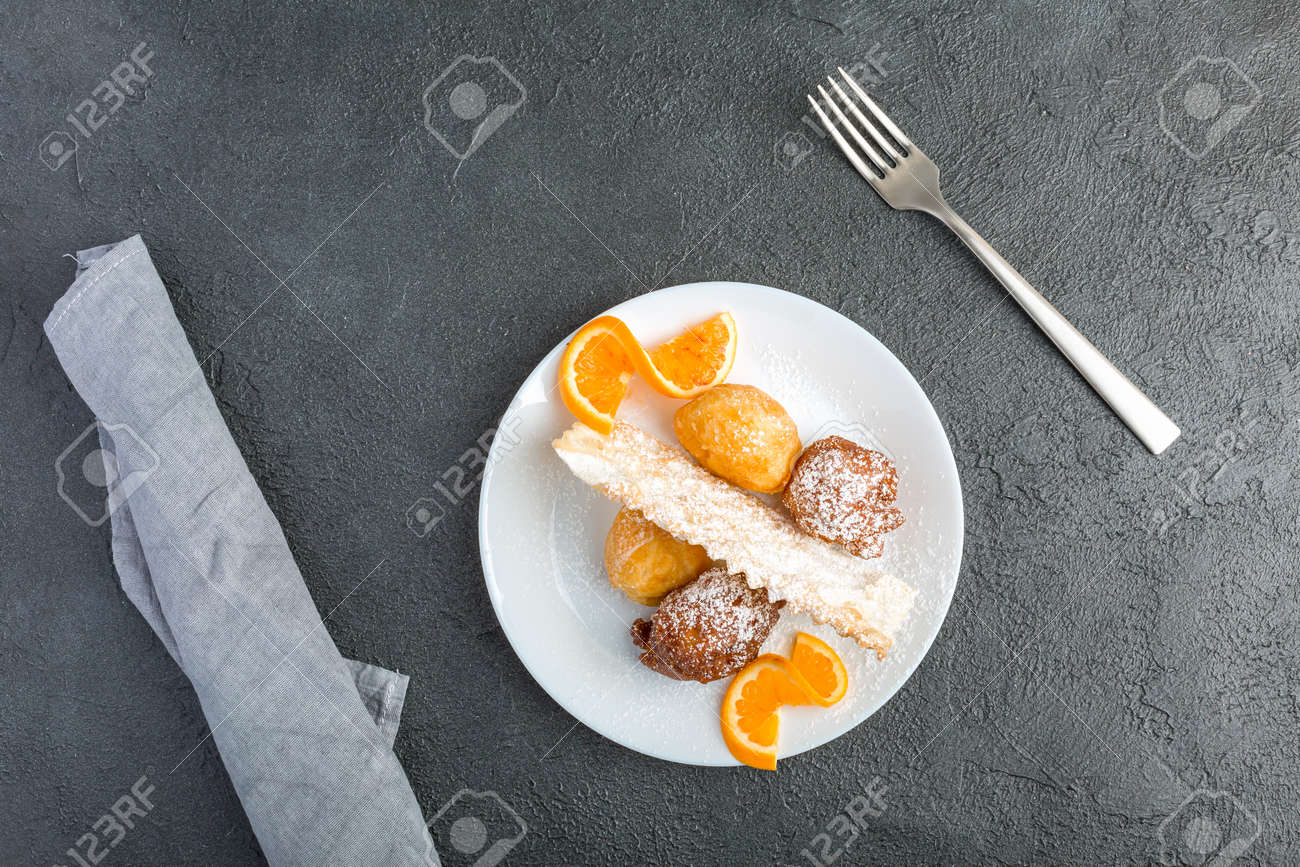 Carnival dessert on plate isolated on black background - 167780025