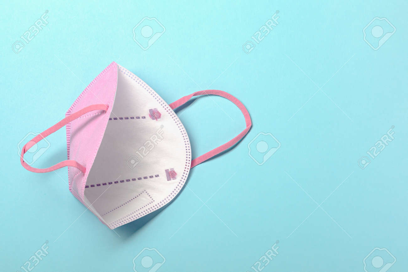 Creative minimal flat lay layer with KN95 or N95 FFP2 mask for protection pm 2.5 - 167780058