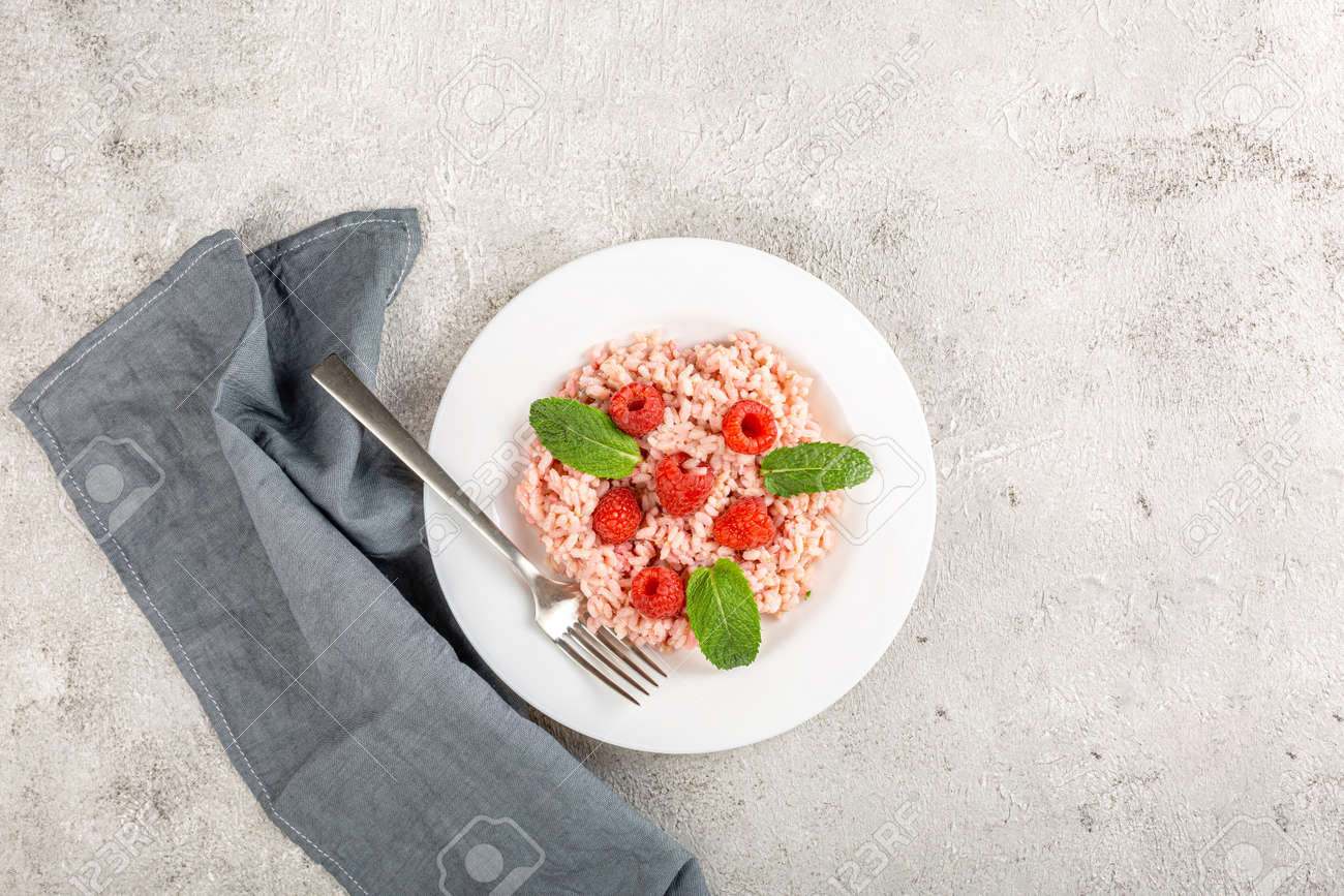 Fresh raspberries risotto a delicate and elegant dish - 171980437