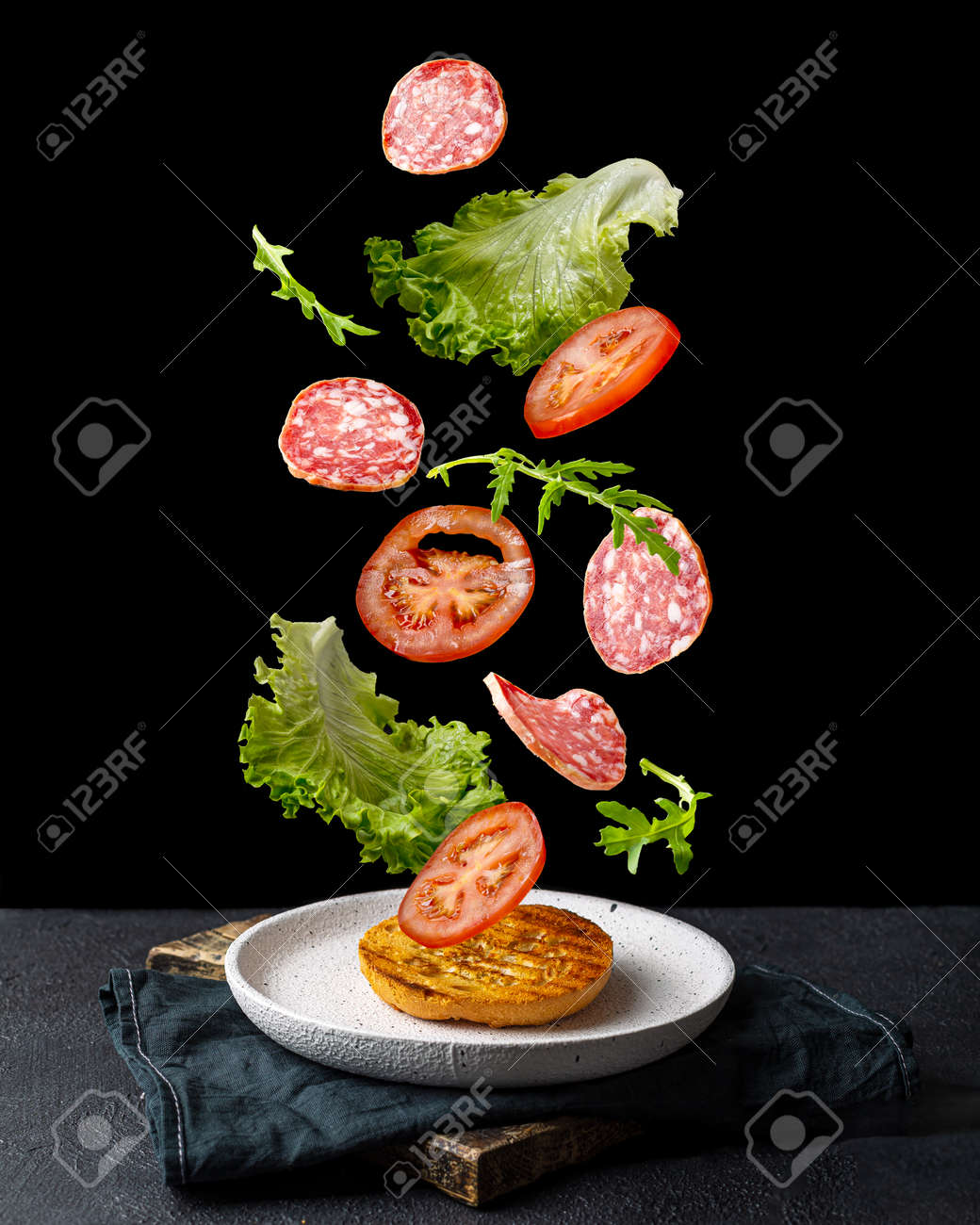 Creative concept with falling food on black backdrop - 172180719