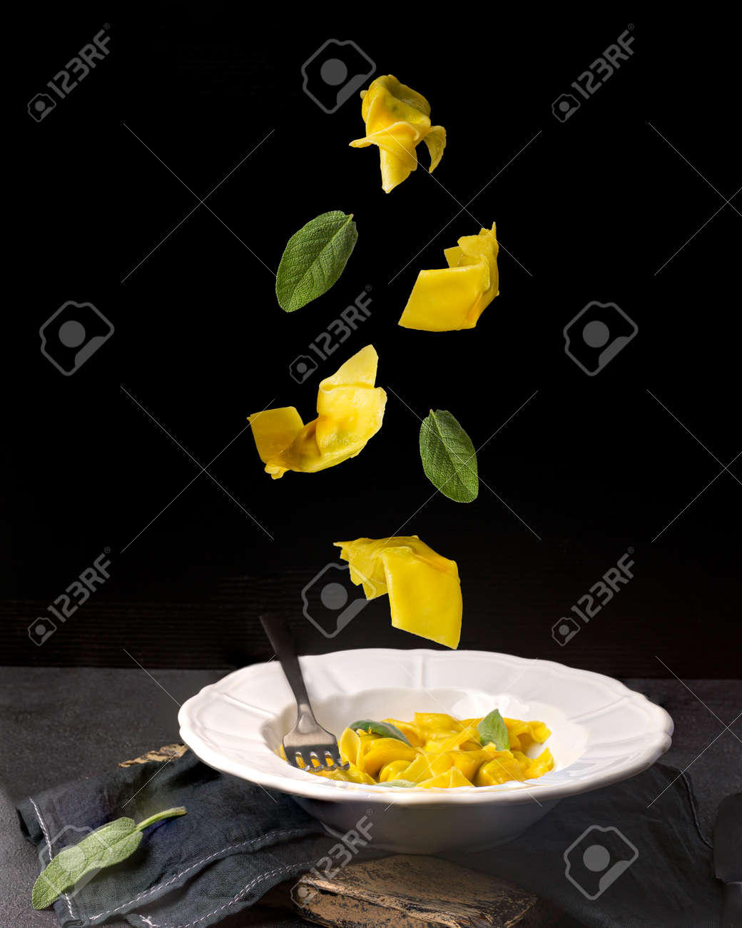 Creative concept with falling food on black backdrop - 172180392