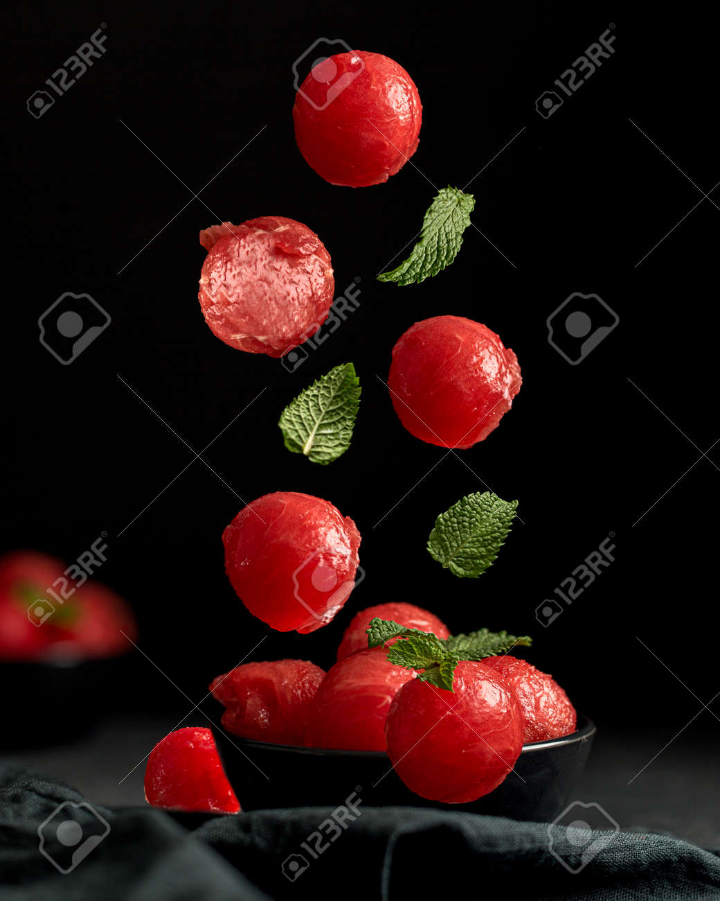 Creative concept with falling food on black backdrop - 173342448