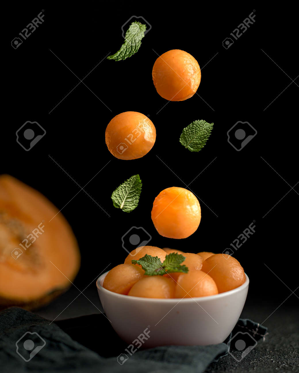 Creative concept with falling food on black backdrop - 173342449