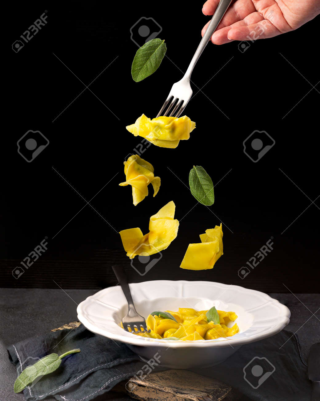 Creative concept with falling food on black backdrop - 173342461