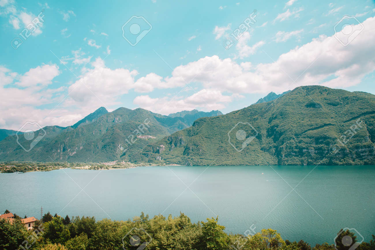 natural landscape with lake and green mountain peaks in summer - 173342521